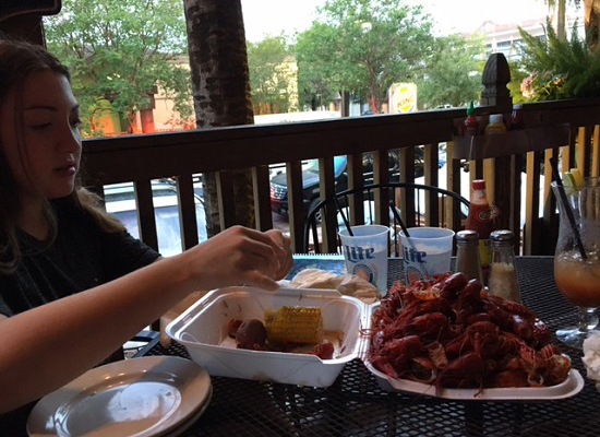 Now it's Talia at the Blind Pelican in NOLA eating crawfish for the first time.